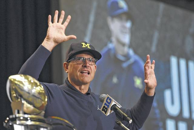 Michigan head coach Jim Harbaugh speaks Tuesday at Big Ten Football Media Days in Chicago.