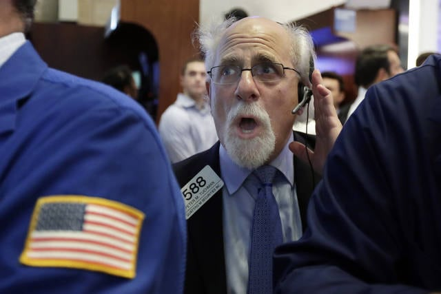 Trader Peter Tuchman works on the floor of the New York Stock Exchange, Monday, July 17, 2017. Stocks are starting the week mostly lower, having closed at all-time highs the week before. (AP Photo/Richard Drew)