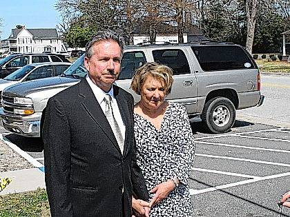 In a March 9, 2015, file photo, Richard and Elizabeth Jones, whose daughter was killed by a train on a Georgia movie set in 2014, speak with reporters outside the Wayne County Courthouse, in Jesup, Ga., after the film's director and executive producer pleaded guilty to charges of involuntary manslaughter and criminal trespassing. A railroad owner must pay $3.9 million to the family of of Sarah Jones, a movie worker killed on a Georgia railroad trestle in 2014, a jury decided Monday in a civil verdict that found the company shared in the blame for the deadly freight train collision even though the film crew was trespassing.
