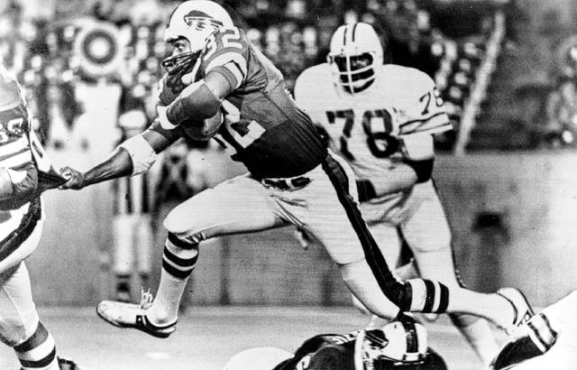 In this Sept. 3, 1977, file photo, Buffalo Bills' O.J. Simpson (32) runs past Tampa Bay Buccaneers' Council Rudolph (78) during an NFL football game in Buffalo, N.Y. Simpson, the former football star, TV pitchman and now Nevada prison inmate, will have a lot going for him when he appears before state parole board members Thursday seeking his release after more than eight years for an ill-fated bid to retrieve sports memorabilia.