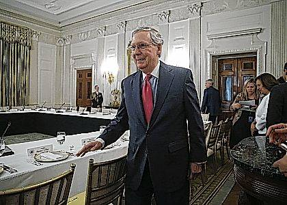 "Senate Majority Leader Mitch McConnell of Ky. walks to his seat for a luncheon between GOP leadership and President Donald Trump on Wednesday in the State Dinning Room of the White House in Washington. Americans overwhelmingly want lawmakers of both parties to negotiate on health care, with only 13 percent supporting Republican moves to repeal ""Obamacare"" absent a replacement, according to a new poll."
