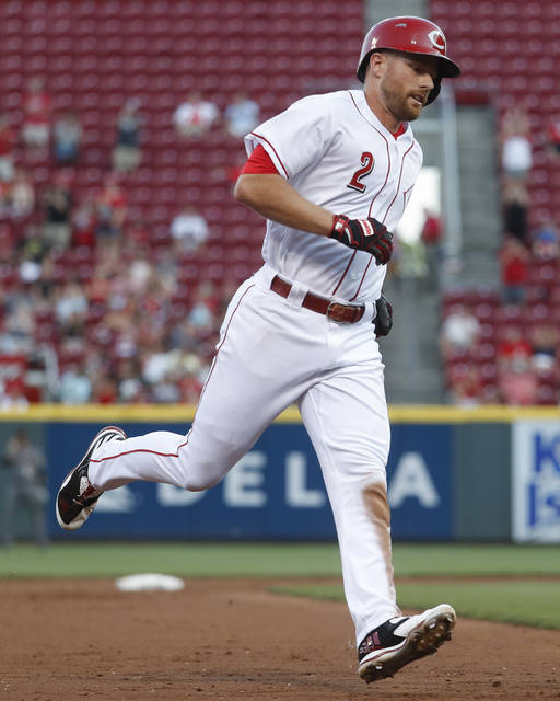 Cincinnati Reds' Zack Cozart runs the bases after hitting a solo home run off Arizona Diamondbacks starting pitcher Zack Greinke in the third inning of a baseball game, Wednesday, July 19, 2017, in Cincinnati. (AP Photo/John Minchillo)