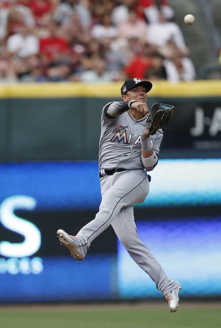 Miami Marlins shortstop Miguel Rojas throws to first on a single by Cincinnati Reds' Billy Hamilton during the first inning of a baseball game, Saturday, July 22, 2017, in Cincinnati. (AP Photo/Gary Landers)