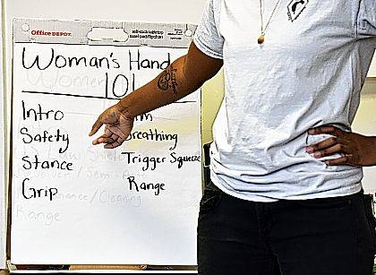 In this May 27, 2017, photo, Marchelle Tigner, a firearms instructor, goes over a list of firearms safety tips during a class in Lawrenceville, Ga. Tigner's goal is to train 1 million women how to shoot a gun in her lifetime. She is among the nation's black women gun owners who say they are picking up firearms for self-protection. (AP Photo/Lisa Marie Pane)