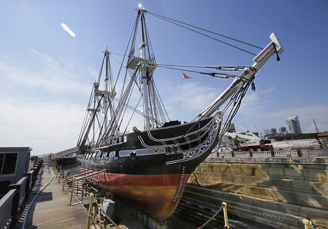 "ADDS THAT THIS IS THE OLDEST COMMISSIONED WARSHIP STILL AFLOAT - In this Monday, July 17, 2017 photo the USS Constitution, ""Old Ironsides,"" the world's oldest commissioned warship still afloat, sits in dry dock in Boston after a more then two year long restoration. The ship is scheduled to be refloated overnight Sunday July 23, 2017 and be docked back at its berth by Monday morning July 24, 2017. (AP Photo/Stephan Savoia)"