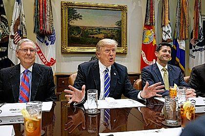 """FILE - In this March 1, 2017 file photo, President Donald Trump, flanked by Senate Majority Leader Mitch McConnell of Ky., left, and House Speaker Paul Ryan of Wis., speaks during a meeting with House and Senate leadership, in the Roosevelt Room of the White House in Washington. Repeal and replace """"Obamacare."""" Just repeal. Or let it fail _ maybe with a little nudge. President Donald Trump has sent a flurry of mixed messages, raising questions about the White House strategy on health care.  (AP Photo/Evan Vucci, File)"""