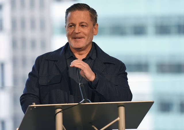 "In this Feb. 3 file photo, billionaire businessman Dan Gilbert speaks at a news conference in Detroit. Gilbert, founder of Quicken Loans Inc. and the majority owner of the Cleveland Cavaliers, apologized for his real estate company's controversial sign in downtown Detroit that says ""See Detroit Like We Do"" with an image of a majority white crowd. Gilbert posted on Facebook on Sunday saying the ad was ""tone deaf"" and his Bedrock company ""screwed up badly."""