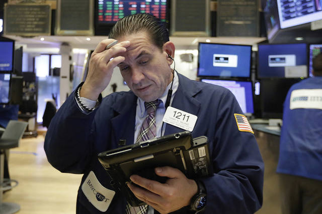 Trader Tommy Kalikas works on the floor of the New York Stock Exchange, Monday, July 24, 2017. Stocks are off to a mixed start on Wall Street as declines in health care and consumer-focused companies outweigh gains in other parts of the market. (AP Photo/Richard Drew)