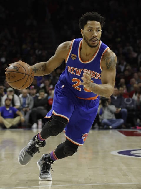 FILE - In this March 3, 2017, file photo, New York Knicks' Derrick Rose drives down court during an NBA basketball game against the Philadelphia 76ers, in Philadelphia.  Two people familiar with the negotiations say former MVP Derrick Rose is meeting with the Cleveland Cavaliers. Rose is discussing a potential contract with Cleveland on Monday, July 24, 2017, according to the people who spoke to The Associated Press on condition of anonymity because of the sensitive nature of the talks. (AP Photo/Matt Slocum, File)