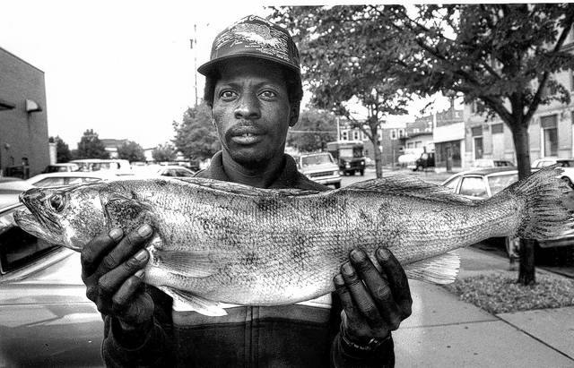Sandy Pickens poses with 28-inch walleye caught at Lake Erie in the 1990s.