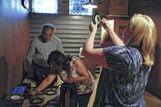 """United Airlines employees, including Nikole Rucinski, right, take part in a corporate team building exercise, working together to free themselves from an """"escape room"""" at PanIQ Escape Room Chicago on June 29."""