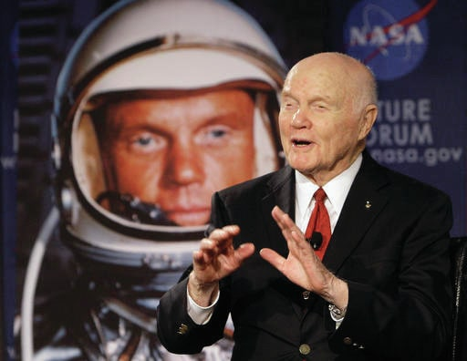 "In this Feb. 20, 2012, file photo, U.S. Sen. John Glenn talks with astronauts on the International Space Station via satellite before a discussion titled ""Learning from the Past to Innovate for the Future"" in Columbus, Ohio. Glenn's devotees are pushing forward with ideas for memorials and honors as the anniversary of the astronaut's birth arrives Tuesday, July 18, 2017, for the first time since his death on Dec. 8, 2016, at age 95. (AP Photo/Jay LaPrete, File)"