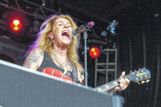 Lita Ford sings and plays guitar during her performance Saturday evening at the Loud-N-Lima music festival.