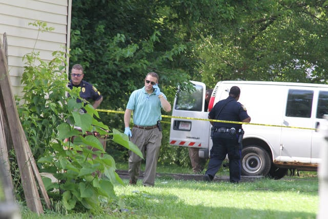 Police investigate the body of a young girl on Holmes Avenue on Sunday evening.
