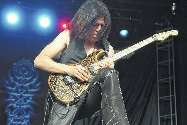 Dokken guitarist Jon Levin shows off his skills on the first day of music at Loud N Lima at the Allen County Fairgrounds Friday.