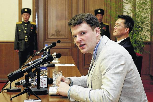 FILE - In this Feb. 29, 2016 file photo, American student Otto Warmbier speaks as Warmbier is presented to reporters in Pyongyang, North Korea. U.S. officials say the Trump administration will ban American citizens from traveling to North Korea following the death of university student Otto Warmbier, who passed away after falling into a coma into a North Korean prison.
