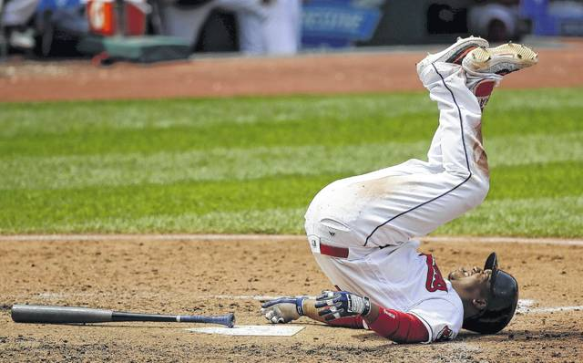 The Indians' Jose Ramirez falls to the ground after swinging at a pitch from Colorado's Antonio Senzatela during Wednesday's game in Cleveland.