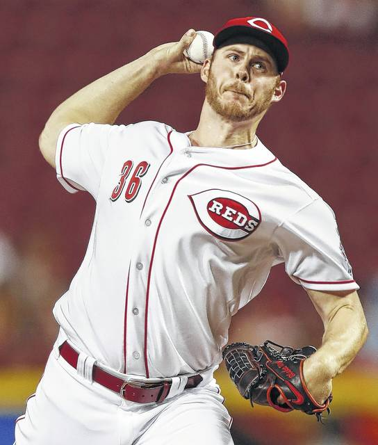 Reds relief pitcher Blake Wood throws during the ninth inning of Wednesday night's game against San Diego in Cincinnati.