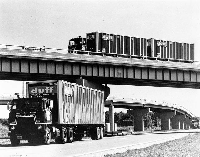 """This undated photo displays Duff equipment. Advertisements described the trucking company this way: """"Whether your shipment require flats, open tops or volume vans, your problem is to choose the carrier who has the equipment to do the job — and gives you the best possible service and delivery. Duff maintains a fleet second to none to meet your individual shipping problem."""""""