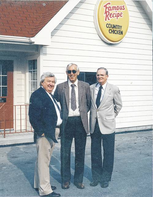 "Lee Cummings, Charles ""Chicken Charlie"" Yohe and Harold Omer pose for a photo at Lee's Famous Recipe. This photo is undated."