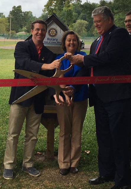 A ribbon cutting ceremony was held at Faurot Park for the Lima Rotary's Little Free Library project. From left: David Frost, past president of the Lima Rotary Club, Tracie Sanchez, president of the Lima Rotary Club and Jed Metzger, president Lima/Allen Chamber of Commerce. Merri Hanjora The Lima News