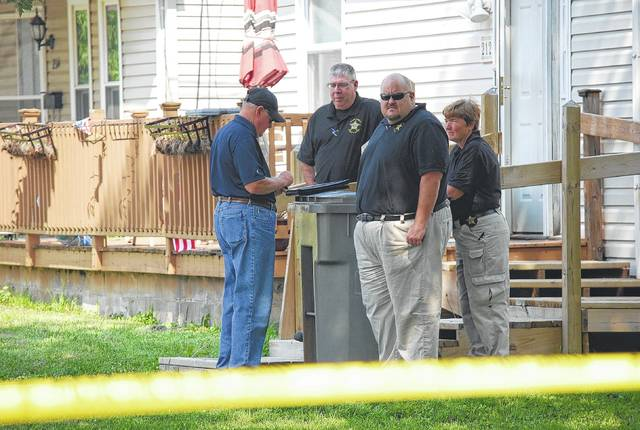 Members of the West Central Ohio Crime Task Force were joined by officers from the Federal Bureau of Investigation, Drug Enforcement Agency and Alcohol Tobacco and Firearms unit in securing a portion of West Michigan Avenue following a Thursday morning shooting.