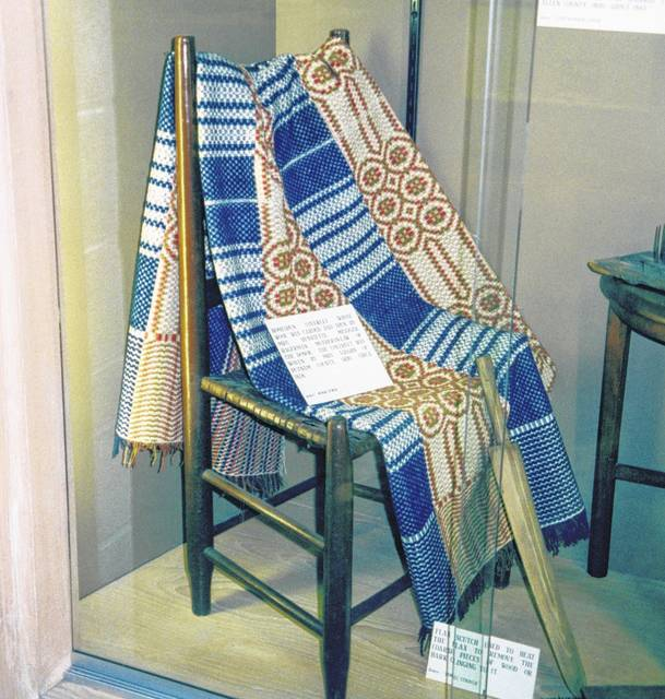 A coverlet in rust, green, blue and white which was woven near Vaughnsville about 1858. The wool was carded and spun by Mrs. Henrietta Metzger Mageman, mother of donor Mrs. Miner Atmur, and woven by Martha Evans (Mrs. Daniel C.) Vaughn, for whom Vaughnsville was named.
