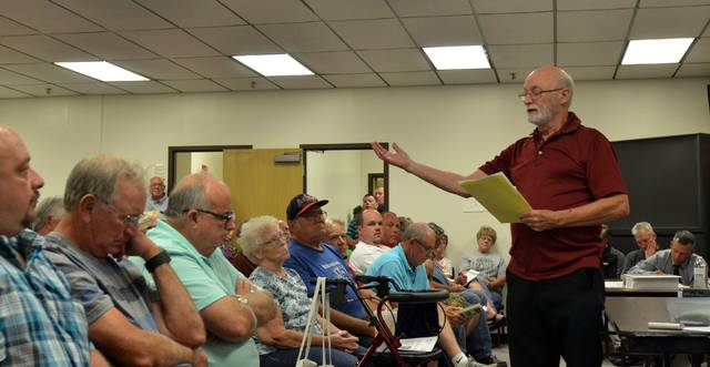 Celina resident Charles Wurster expresses opposition to a proposed dairy farm that would be located a half-mile from his home during a public meeting Tuesday night. More than 20 residents came out against the dairy farm at the meeting, which saw over 150 people turn out.