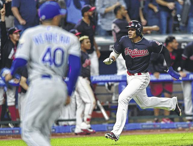 The Indians' Erik Gonzalez scores on a double by Francisco Lindor during the ninth inning of Thursday night's game against Kansas City in Cleveland.