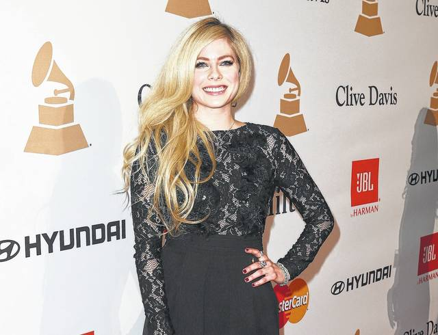 In this Feb. 14, 2016 file photo, Avril Lavigne arrives at the 2016 Clive Davis Pre-Grammy Gala in Beverly Hills, Calif. Cybersecurity firm McAfee said Tuesday that Lavigne, whose last album came out in 2013, was the most likely celebrity to land users on websites that carry viruses or malware. Searches for Lavigne have a 14.5 percent chance of landing on a web page with the potential for online threats, a number that increases to 22 percent if users type her name and search for free MP3s.