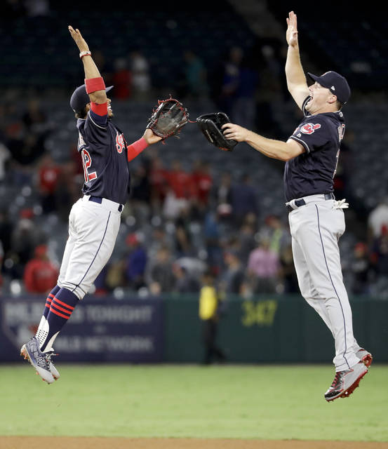Cleveland Indians shortstop Francisco Lindor, left, and right fielder Jay Bruce celebrate after their 6-5 win against the Los Angeles Angels during a baseball game in Anaheim, Calif., Wednesday, Sept. 20, 2017. (AP Photo/Chris Carlson)