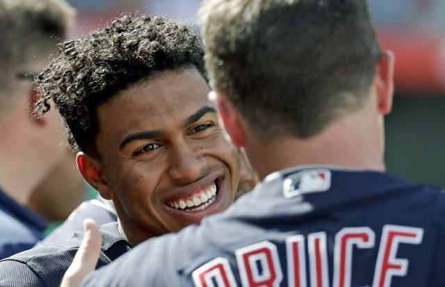 Cleveland Indians shortstop Francisco Lindor, left, talks with right fielder Jay Bruce on the bench during the sixth inning of a baseball game against the Los Angeles Angels in Anaheim, Calif., Thursday, Sept. 21, 2017. (AP Photo/Chris Carlson)