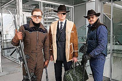 "This file image released by Twentieth Century Fox shows, from left, Taron Egerton, Colin Firth, and Pedro Pascal in ""Kingsman: The Golden Circle."" The R-rated spy comedy ""Kingsman: The Golden Circle"" has taken over the top spot at the North American box office with an estimated $39 million debut. The 20th Century Fox release pushed the Stephen King sensation ""It"" into second place in its third week of release."