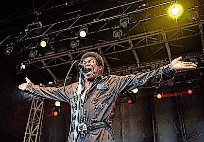 FILE - In this June 24, 2017 file photo, soul singer Charles Bradley performs with at the inaugural 2017 Arroyo Seco Music Festival in Pasadena, Calif. His publicist said Bradley died Saturday, Sept. 23, 2017 after a battle with stomach cancer. He was 68. (Photo by Chris Pizzello/Invision/AP, File)