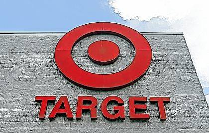FILE - This Wednesday, June 29, 2016, file photo, shows a Target store in Hialeah, Fla. Target Corp. is raising its minimum hourly wage for its workers to $11 starting in October 2017 and then to $15 by the end of 2020 in a move it says will help it better recruit and retain staff and provide a better shopping experience for its customers. (AP Photo/Alan Diaz, File)