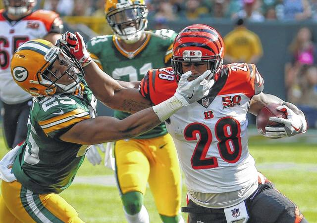 Cincinnati Bengals' Joe Mixon tries to get past Green Bay Packers' Marwin Evans during the first half of an NFL football game Sunday.