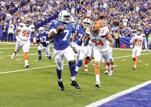 Indianapolis Colts quarterback Jacoby Brissett (7) runs in for a touchdown in front of Cleveland Browns defensive end Carl Nassib (94) during the first half of an NFL football game in Indianapolis, Sunday, Sept. 24, 2017. (AP Photo/Darron Cummings)