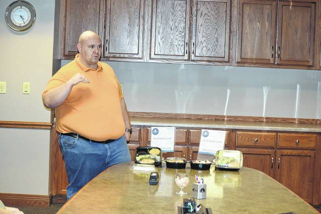 Jonathan Keysor shows off a few of the meals available from Fit Meals Lima.