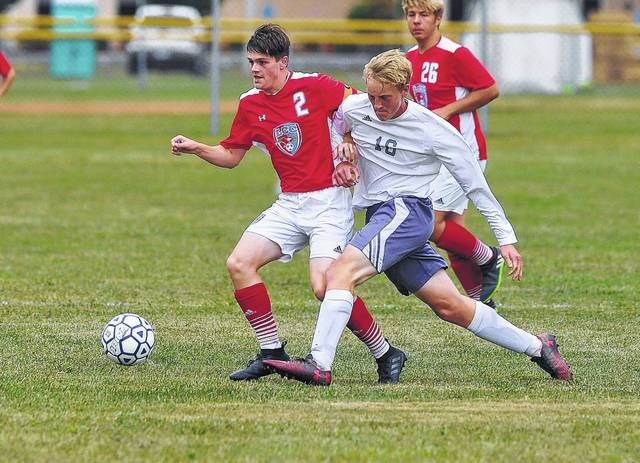 Lima Central Catholic's Trey Horstman (left) battles with Temple Christian's Cameron Worsham during Thursday's match at Temple Christian.