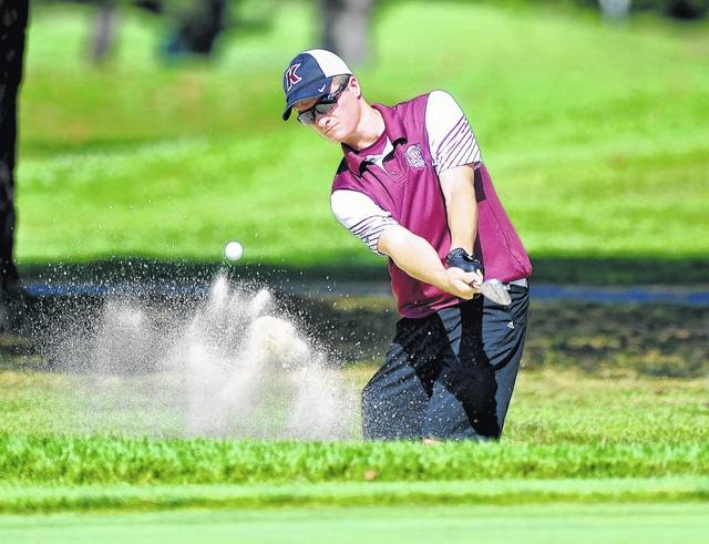 Kalida's Josh Klausing hits from a bunker on the second hole during Monday's PCL Conference Tournament at Delphos Country Club.  RICHARD PARRISH / The Lima News