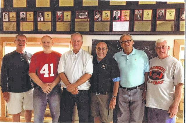 NOW — Members of the 1966 Shawnee football team in a recent photo are (l-r) Bob Brumby, Bill Hamman, Tom Trump, Jeff Howison, Steve Acker and Russ Fruchey.