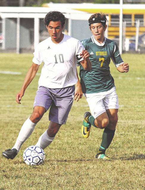 Lima Temple Christian's Cameron Worsham travels into Ottoville territory for a shot on goal Monday afternoon. Worsham scored twice for the Pioneers and set a a new school career scoring record.