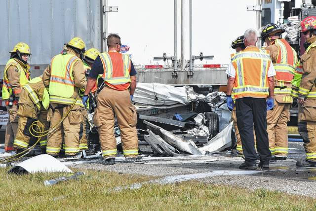 First-responders work at the scene of a fatal accident Wednesday on U.S. Route 30 near Van Wert.