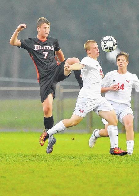 Wapakoneta's Payne Harsbarger and Elida's Noah Davis compete for the ball during Monday's match at Ryan Filed in Wapakoneta. Elida's Seth Mahlmeister competes with Wapakoneta's Seth Ricketts during Monday's match at Ryan Filed in Wapakoneta. Mahlmeiser recorded the hat trick against the Redskins.
