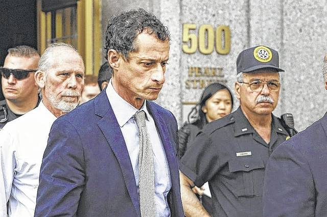 Former Congressman Anthony Weiner leaves federal court following his sentencing, Monday, in New York. Weiner was sentenced to 21 months in a sexting case that rocked the presidential race. (AP Photo/Mark Lennihan)