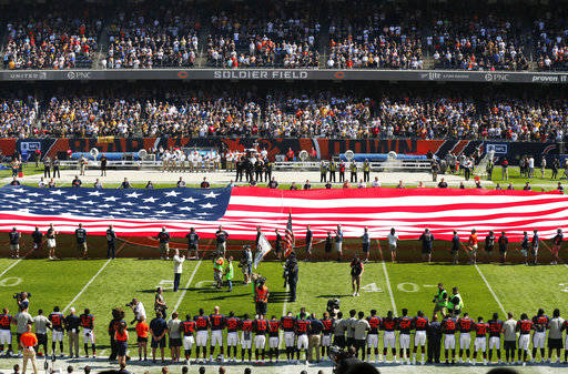 The Pittsburgh Steelers side of the field is nearly empty during the playing of the national anthem before an NFL football game between the Steelers and Chicago Bears, Sunday, Sept. 24, 2017, in Chicago. (AP Photo/Kiichiro Sato)