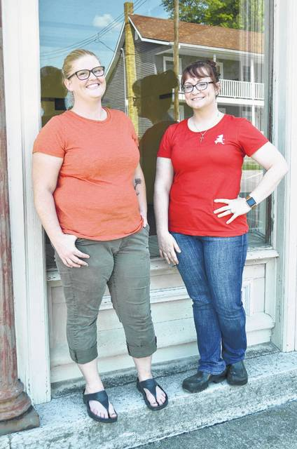 Kelly Wolfe (left) and her business partner Brandi Smith are the driving force behind Little Red, a home bakery currently run out of Wolfe's home. Little Red fry pies, and other treats, can be found at Kohls and coffee and tea shops in Toledo, Findlay and Arlington. The two women are standing before the two story, red brick building they're refurbishing into a retail bakery they hope to have open by the holidays this year.