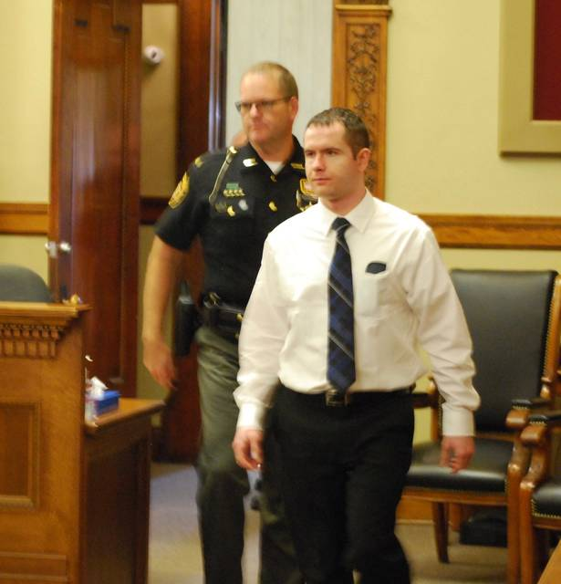Christopher Peters enters the courtroom during proceedings Wednesday.