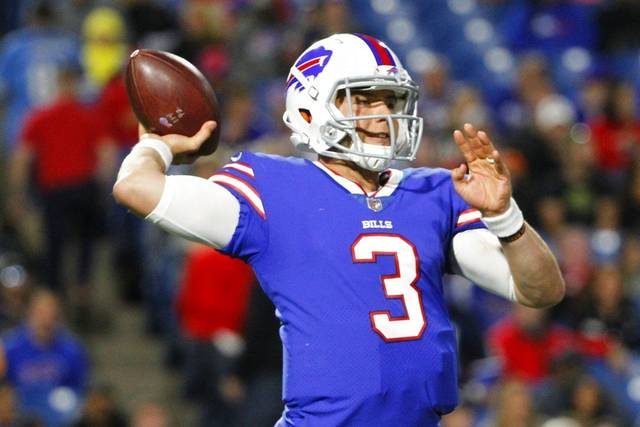 The Buffalo Bills' Keith Wenning (3) throws a pass during the first half of a preseason NFL football game against the Detroit Lions Thursday, Aug. 31, 2017, in Orchard Park, N.Y.
