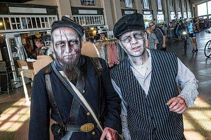 In a Oct. 7, 2017 photo, Tom Pryor of Old Bridge and Dave Fischer of South Ambory appear at the Asbury Park Zombie Walk in Asbury Park NJ.  (Peter Ackerman/The Asbury Park Press via AP)
